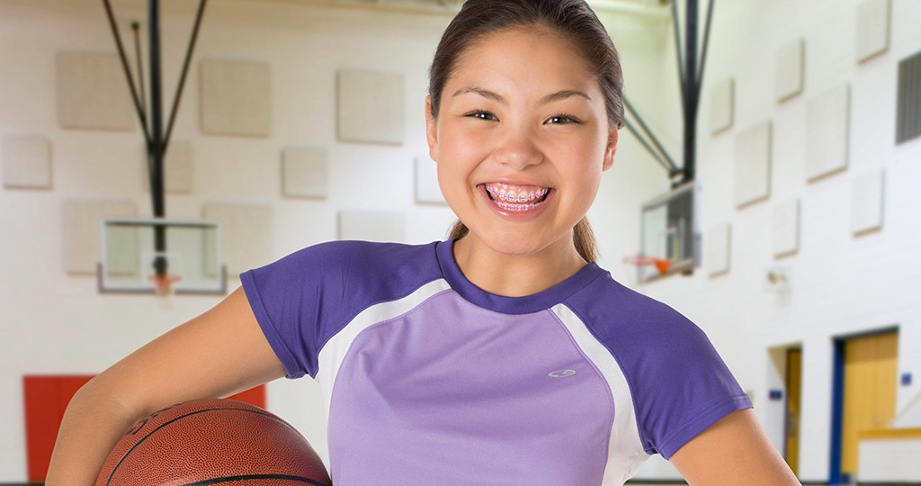 Smiling teen with basketball